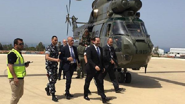 Hariri stepping off a helicopter on his way to a tour of south Lebanon