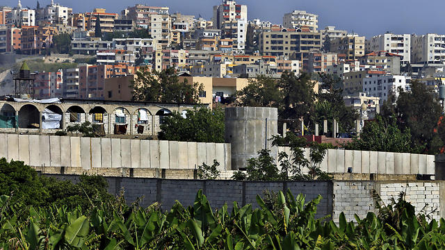 In this Friday, May 5, 2017 photo, a general view of the concrete wall surrounding the Ein el-Hilweh Palestinian refugee camp near the southern port city of Sidon, Lebanon. (Photo: AP) (Photo: AP)