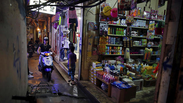 In this Thursday, May 4, 2017 photo, a teenager rides his scooter inside the Bourj al-Barajneh Palestinian refugee camp in Beirut, Lebanon. (Photo: AP) (Photo: AP)