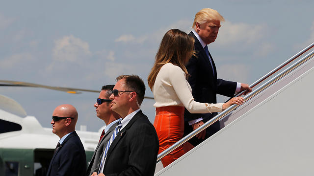 Donald and Melania Trump walking up to Air Force One (Photo: Reuters)