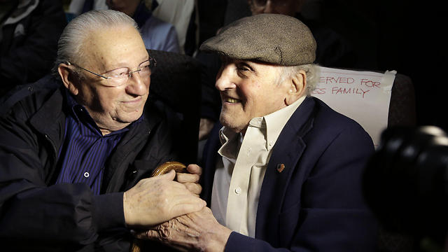 """Holocaust survivors Israel Arbeiter, left, and Steve Ross, right, greet one another at a theater before the premier of the film """"Etched in Glass: The Legacy of Steve Ross,"""" in West Newton, Mass. (Photo: AP) (Photo: AP)"""