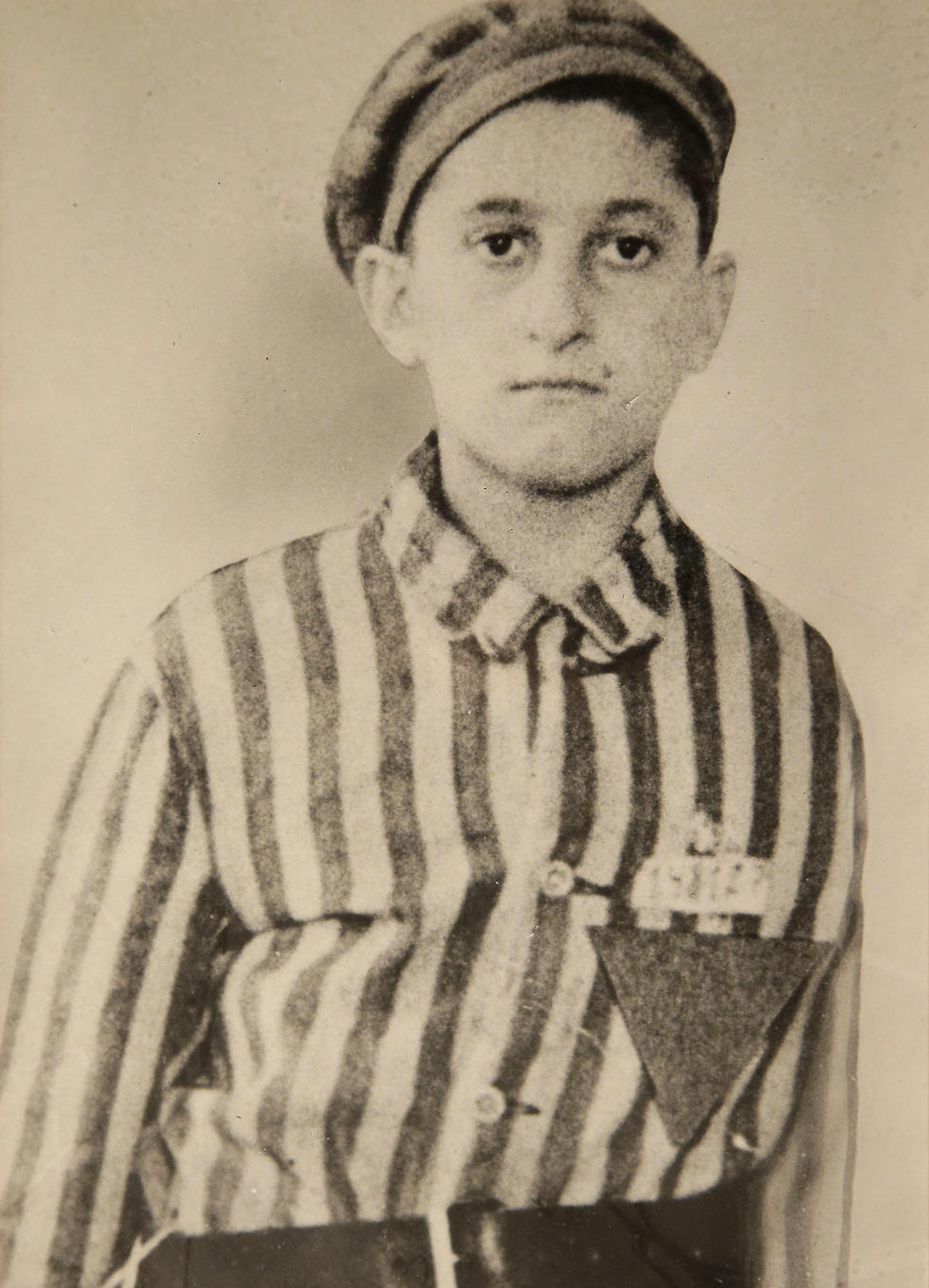 In this undated World War II-era photograph provided by Many Hats Productions, Holocaust survivor Steve Ross wears a Nazi prison camp uniform. (Photo: AP) (Photo: AP)
