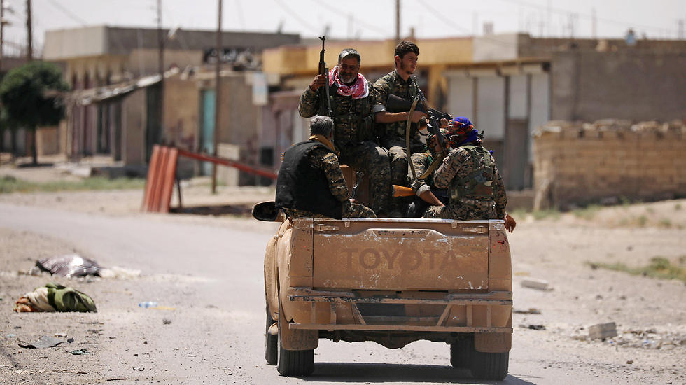 Syrian Democratic Forces fighters in Raqqa (Photo: Reuters) (Photo: Reuters)