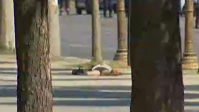 Man laying on ground following attack, unclear whether he is the attacker (Photo: AP)