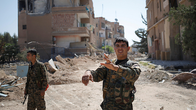 Kurdish fighters in the Syrian city of Raqa, after helping to drive out Islamic State (Photo: Reuters)