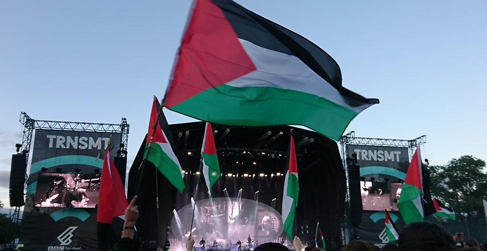 Palestinian flags waving in protest of the concert