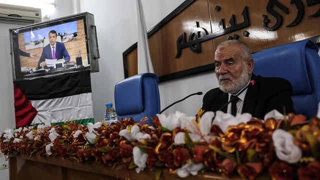 Hamas' MP and head of parliament in Gaza Ahmad Bahar chairs Palestinian legislative Council meeting, as former senior Fatah member Mohammed Dahlan attends meeting via Skype call from United Arab Emirates (Photo: AFP)