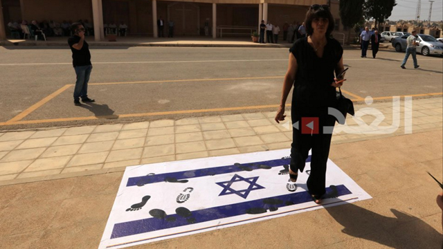Israeli flag being stepped on in response to the incident