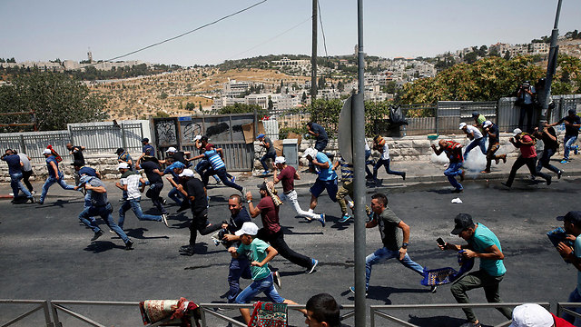 Riots in Jerusalem following placement of metal detectors on Temple Mount in July  (Photo: Reuters)