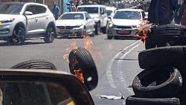 Burning tires in protest in Jaffa