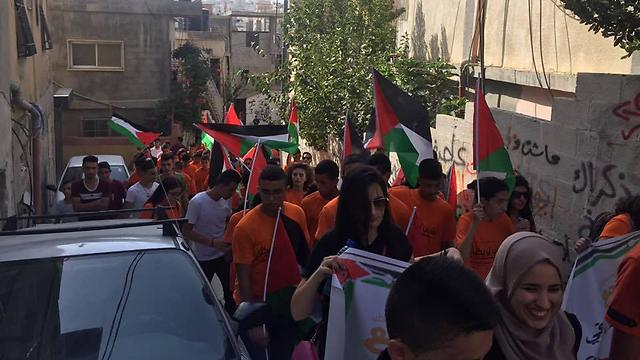 Palestinian flags in Balad summer camp march