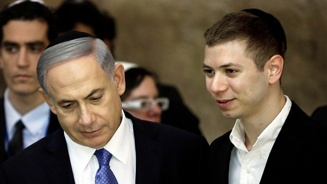 Yair with his father, PM Netanyahu (Photo: AFP)