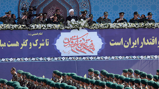 ranian President Hassan Rouhani at a Revolutionary Guards parade (Photo: AFP)