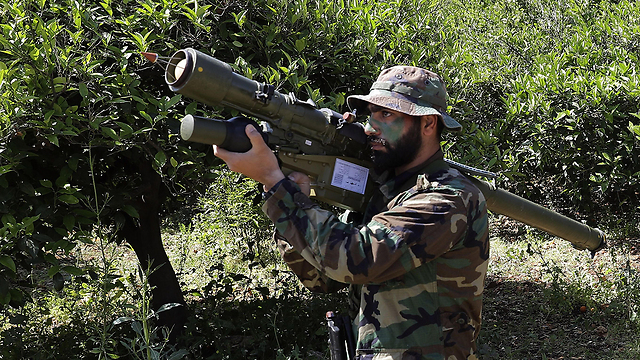 Hezbollah militant near the Lebanon-Israel border (Photo: AFP)