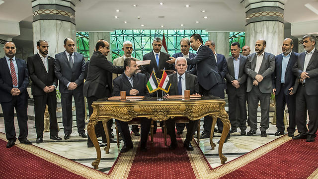 The warring Palestinian sides signed the reconliation agreement a little more than two months ago (Photo: AFP)