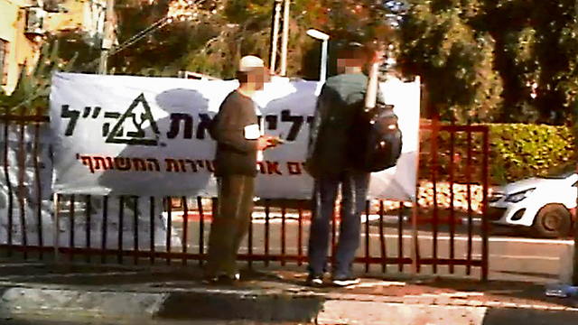 Brothers in Arms activists handing out pamphlets