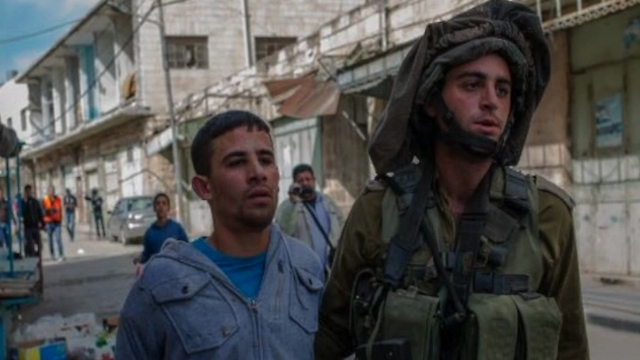 Issacharoff with the Palestinian questioned as part of the investigation. Before an IDF officer is publicly condemned as a known liar, we should raise a warning sign (Photo: Breaking the Silence)