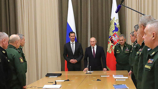 Assad and Putin, surrounded by top Russian security officials