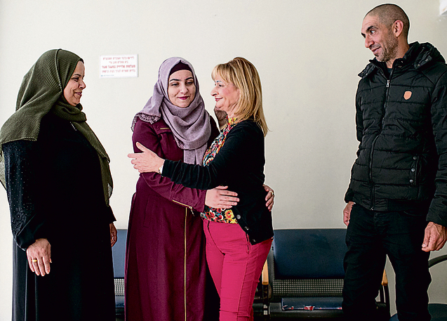 Bassa with Saja, her mother and her uncle. 'I love you. I'm alive thanks to you' (Photo: Ohad Zwigenberg)