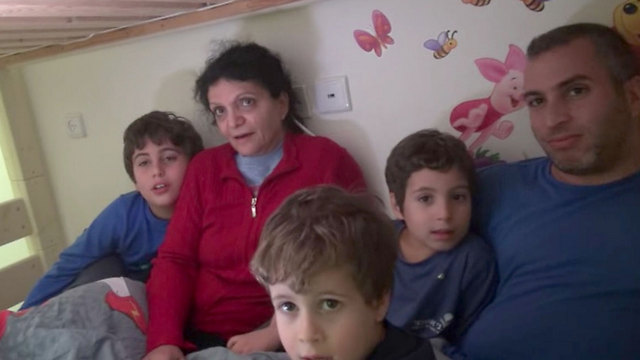 Tal Bornstein, with his mother and three children, spending the night in a security room (Photo: Barel Efraim)