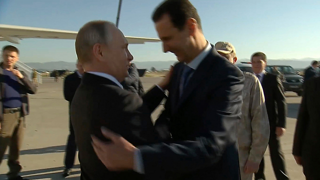 Russian President Putin (L) and his Syrian client Assad (Photo: AP, Presidential TV)
