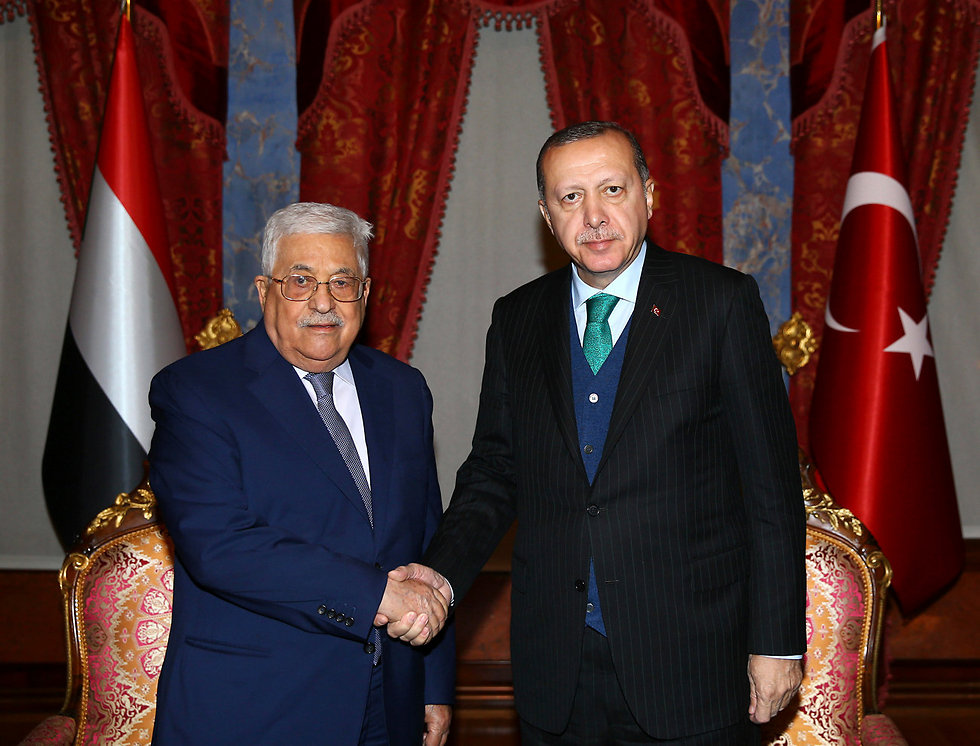 Erdogan, right, welcomes Abbas to Istanbul (Photo: AP)