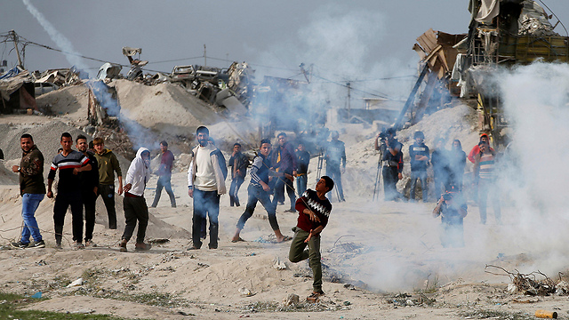 alestinian protestors clash with IDF forces near the Gaza border fence  (Photo: Reuters)