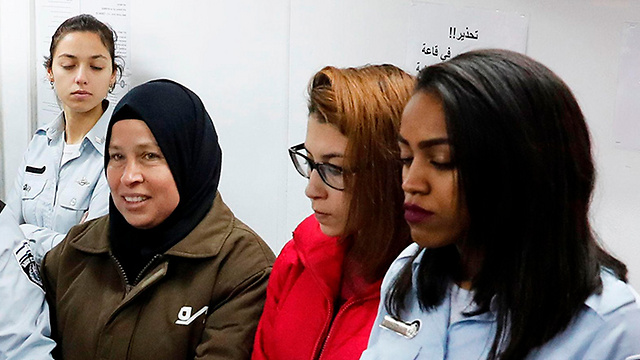 Neriman Tamimi, in brown, and Nur Tamimi, in red (Photo: AFP)
