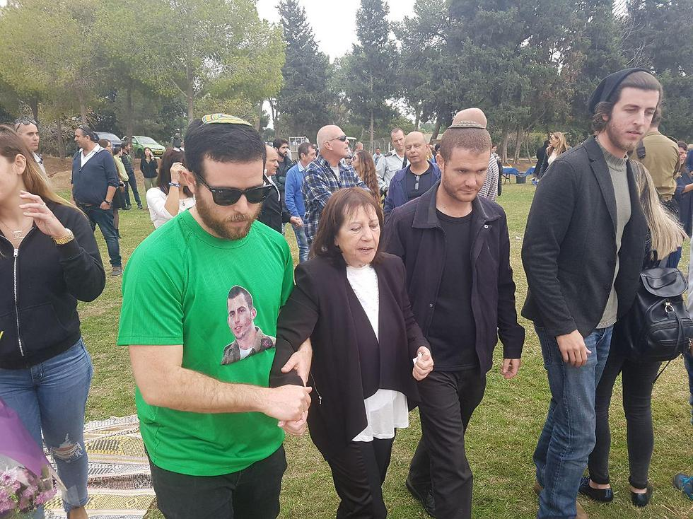The slain soldier's mother being led to a shelter (Photo: Matan Tzuri)