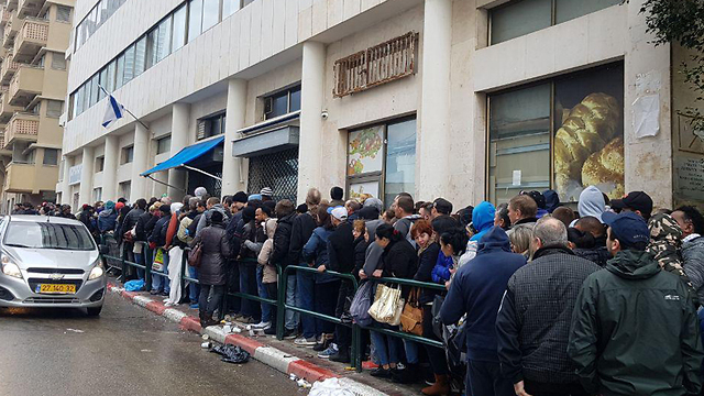Migrants queuing outside the Population and Immigration Authority's offices to submit asylum requests