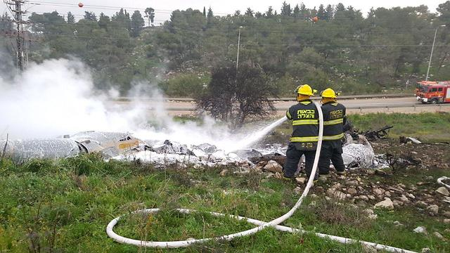 Firemen putting out plane that crashed near kibbutz Harduf (Photo: Fire & Rescue, Northern District)