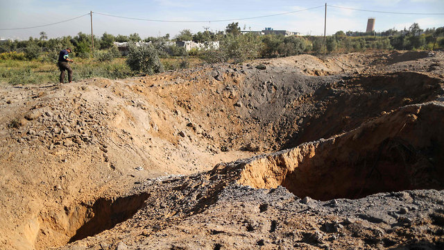 Holes created in the ground as a result of the IDF strike in Gaza on Saturday night  (Photo: AFP)