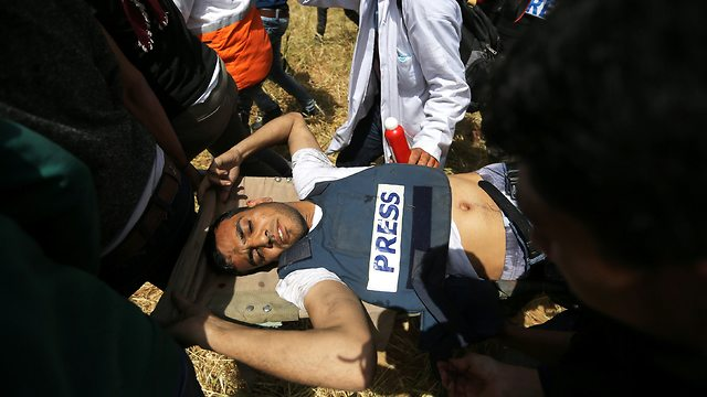 Murtaja moments after being shot (Photo: Reuters)