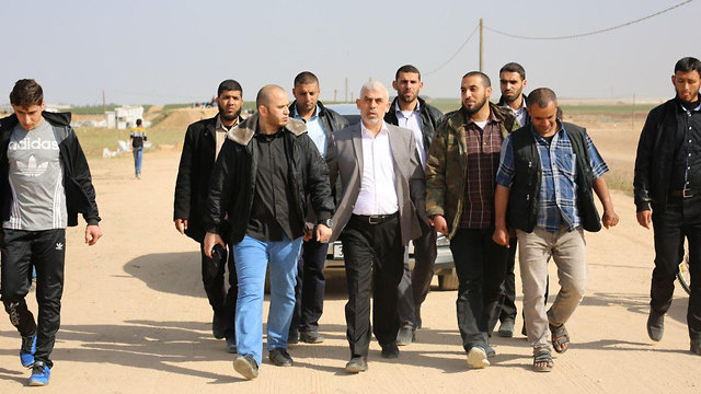 Hamas leader in Gaza Yahya Sinwar touring the border region