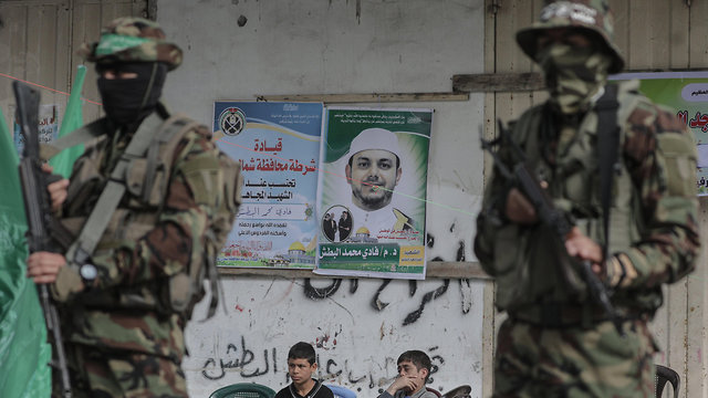 Hamas militants at Albatsh's funeral (Photo: EPA)
