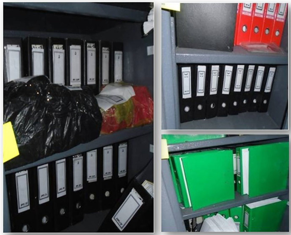 Some of the binders with the documents
