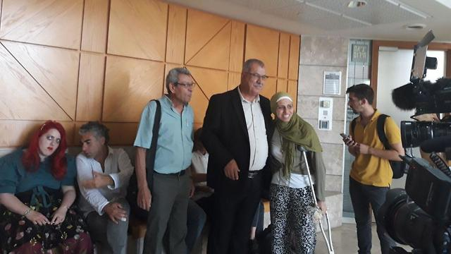 Tatour with her family in court