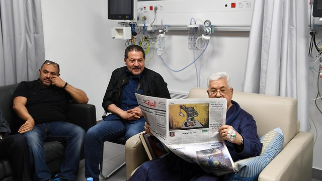 Abbas with sons Yasser and Tareq at the hospital in Ramallah in May (Photo: Reuters)