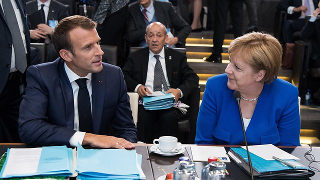 French President Macron with German Chancellor Angela Merkel (Photo: MCT)