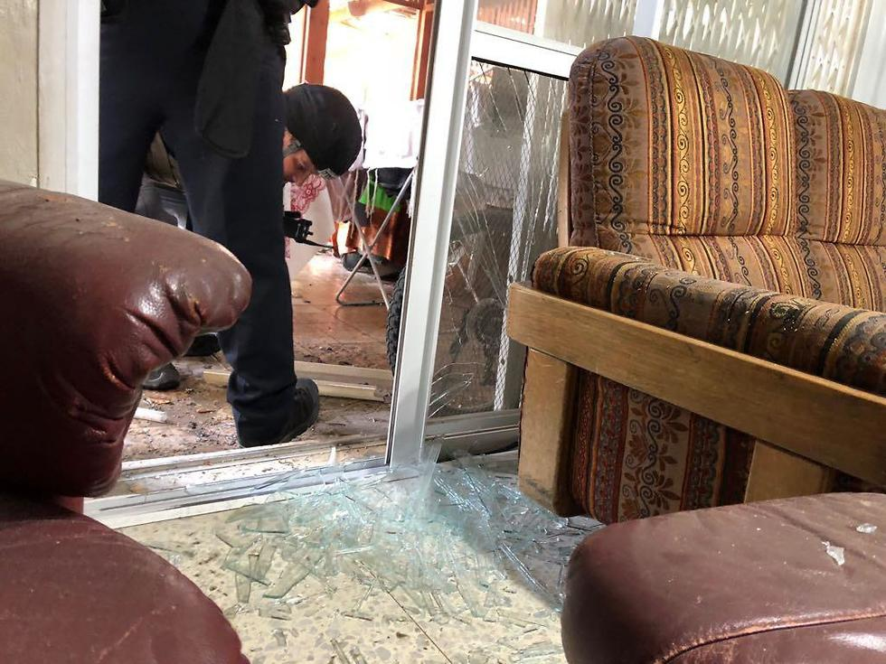 Damage caused to home from rocket shrapnel (Photo: Israel Police)