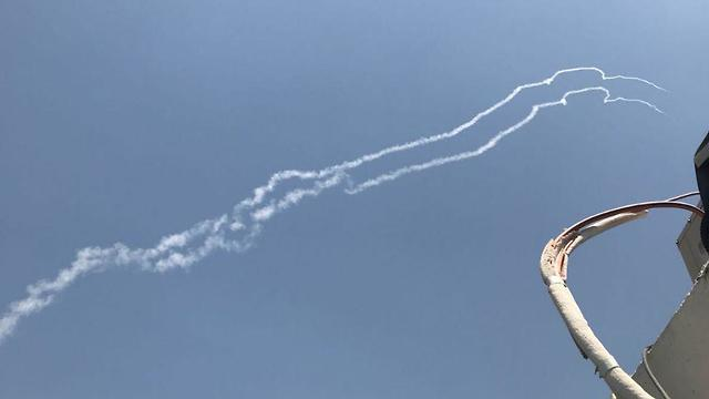 Trails of smoke from Patriot missiles fired at the Syrian jet (Photo: Shimon Elbaz)