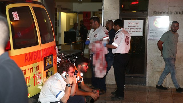MDA paramedics treating the wounded (Photo: Ohad Zwigenberg)