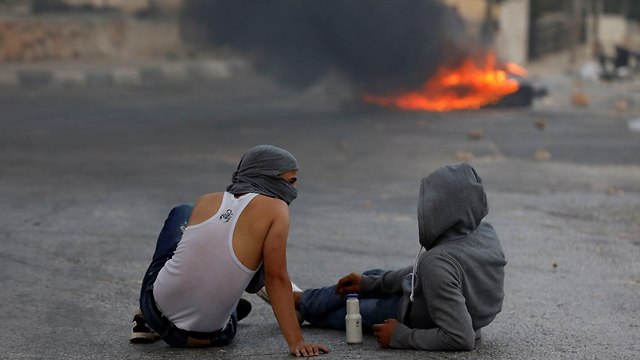 Clashes in Kobar (Photo: Reuters)