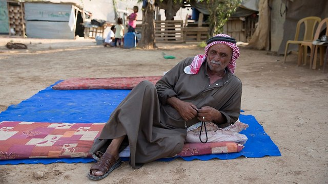 A resident of the Bedouin village (Photo: Amit Shabi)
