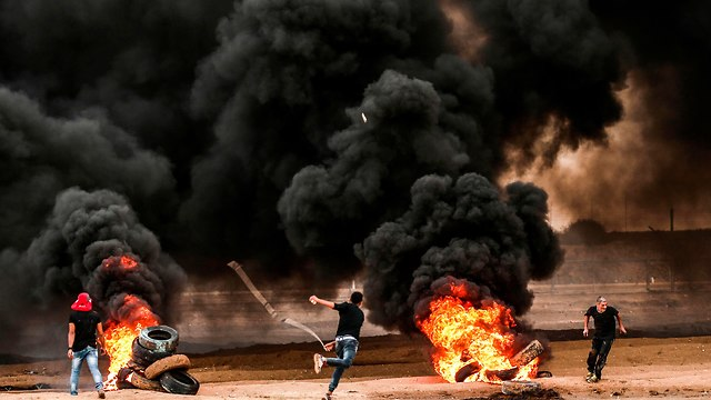 Palestinians rioting on the Gaza border (file photo) (Photo: AFP)