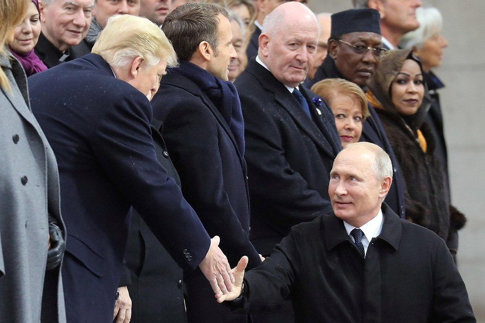 Donald Trump greets Vladimir Putin during the commemorations to mark 100 years since the end of World War II, in Paris in November 2018