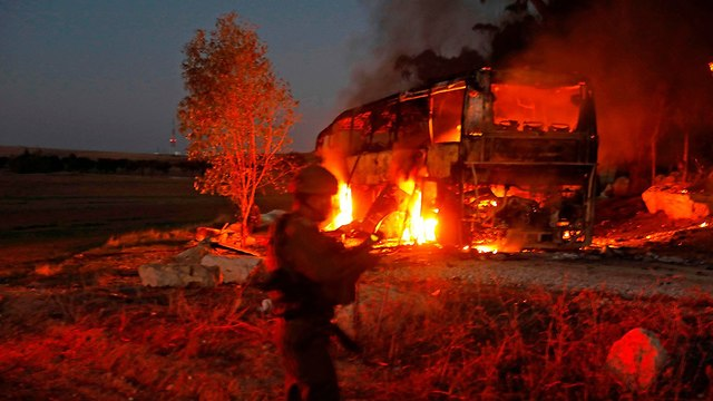 Bus hit by Gaza missile (Photo: AFP)