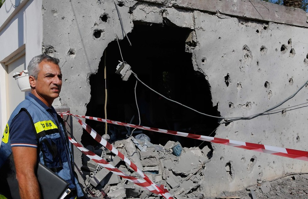House hit by rocket in Ashkelon    (Photo: AFP)