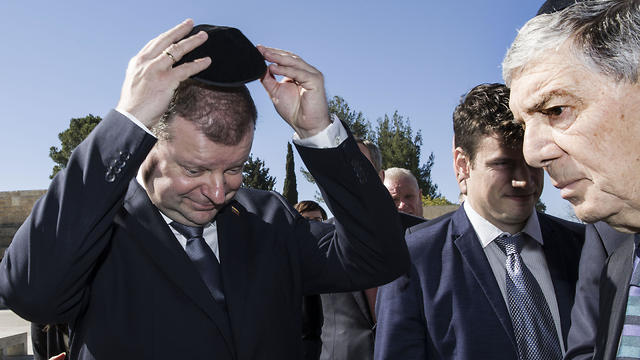 Lithuania's Prime Minister Saulius Skvernelis puts on a kippa as he enters the Hall of Remembrance at the Yad Vashem Holocaust memorial in Jerusalem, Tuesday January 29, 2019