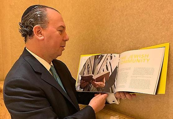 Rabbi Marc Schneier reads the book he helped to write